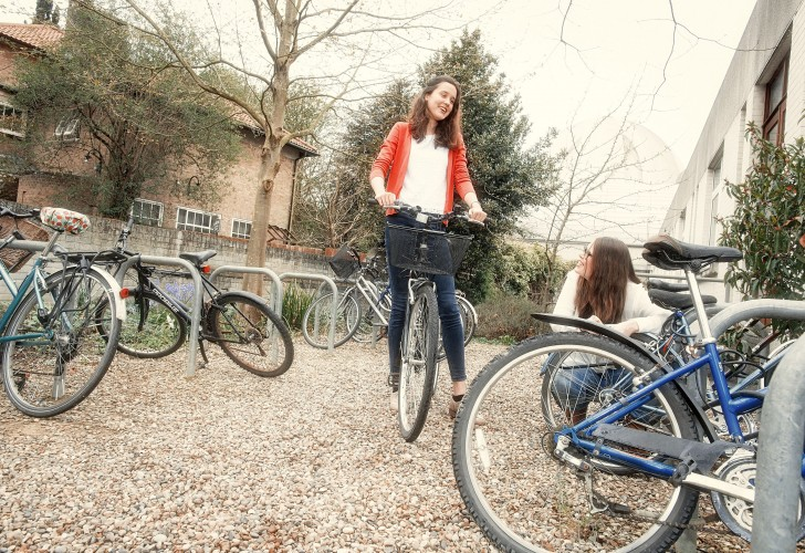 Photo of students outside the bike racks at Murray Edwards College