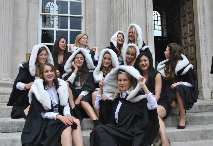 Photo of graduates on the steps at Senate House