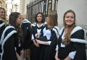 Photo of Murray Edwards graduates outside Senate House