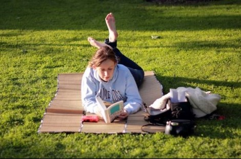 Photo of a student reading in the gardens