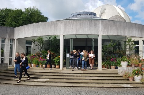 Photo of sixth-form students attending Pathways to Success conference outside the entrance of Murray Edwards College